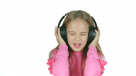 opus : Baby listens to the music in the headphones. White background