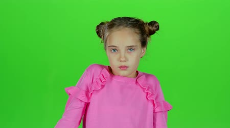 csodálkozás : Child is surprised from what he saw. Green screen. Slow motion