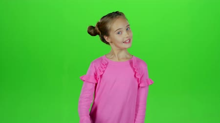 jitters : Little girl screams for her bad mood, shes angry . Green screen. Slow motion Stock Footage
