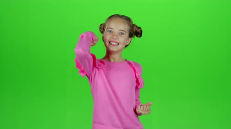 pigtailler : Little girl rejoices in victory. Green screen. Slow motion