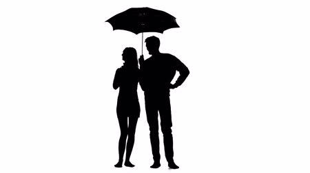 hides : Pair of lovers under an umbrella. White background. Silhouette