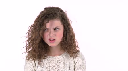 agresif : Little girl screams for her bad mood, shes angry . White background Stok Video