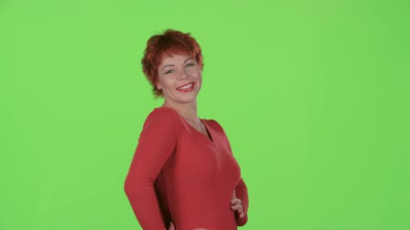 beautifully : Redhaired flirts and winks with the men. Green screen
