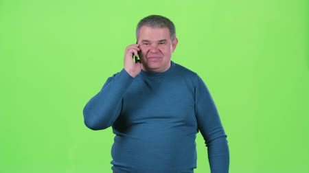 spite : Man is talking on the phone and screaming. Green screen