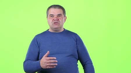 cortes : Man talks about his company and its achievements. Green screen. Slow motion