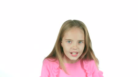 jitters : Little girl screams for her bad mood, shes angry. White background. Slow motion