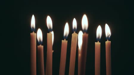 cease fire : Candles are burning in the spacious room and go out. Black background Stock Footage