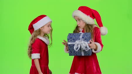 manó : Baby gives a New Year gift to her friend. Green screen. Slow motion Stock mozgókép