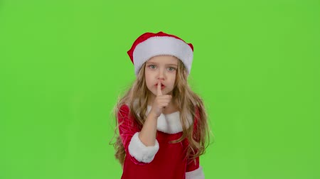 hat : Child girl of the assistant Santa Claus say quietly to their elves. Green screen. Slow motion
