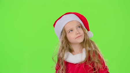 manó : Child holds a gift box in his hands andand smile. Green screen. Slow motion