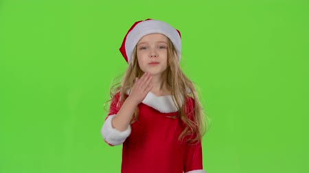manó : Child in red Christmas caps send air kisses. Green screen