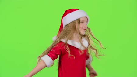 manó : Baby is spinning in her New Years costume. Green screen