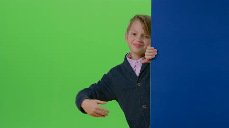 hides : Teen comes out from behind the walls waving and calling to yourself on a green screen