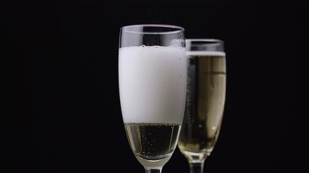 hiss : Champagne poured into glass. Black background. Close up Stock Footage