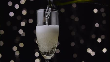 hiss : Champagne poured into glass. Bokeh background