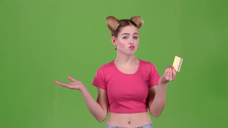 cem : Girl with a gold card upset she does not have money. Green screen. Slow motion