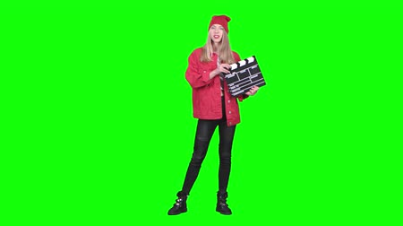 double happiness : Assistant operator holds a clapperboard in the hands. Green screen