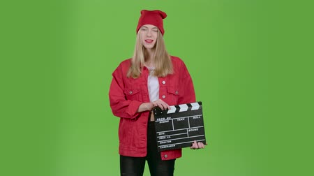 double happiness : Assistant holds a clapperboard in the hands. Green screen Stock Footage