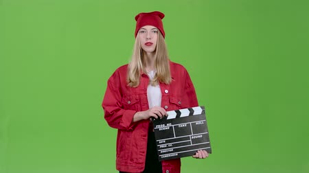 double happiness : Assistant of the operator does the cotton clapperboard and leaves the site. Green screen