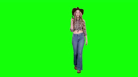 villain : Sheriff girl holds a revolver in her hands and aiming at the villain. Green screen Stock Footage