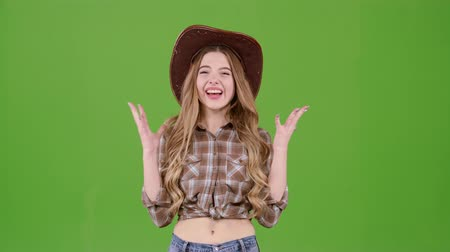 conquest : Girl in the cowboy hat rejoices at the victory. Green screen Stock Footage