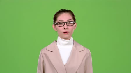 smile : Woman thinks about serious issues and finds a solution. Green screen. Slow motion