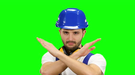 шпатель : Engineer shows the cross crosswise, says no to his workers. Green screen Стоковые видеозаписи