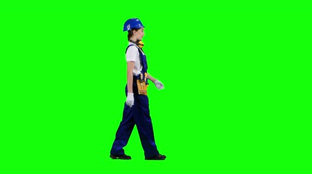 bok : Girl is walking in a helmet to work. Green screen. Side view
