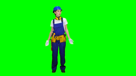bewilderment : Builder girl looks around, looking for her buddies. Green screen Stock Footage