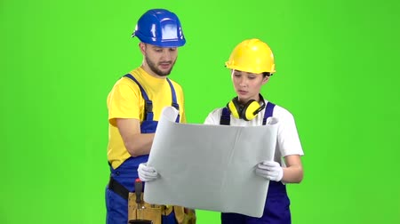 belirtmek : Two architects discuss the drawing of the new building. Green screen. Slow motion Stok Video