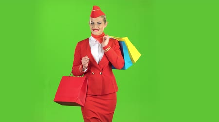 crew : Girl is coming with shopping bags. Green screen