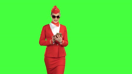 red shoes : Woman in sunglasses steps with the phone and writes a message . Green screen Stock Footage