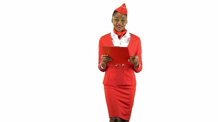 attendant : African american woman steps with a red folder in her hands . Alpha channel