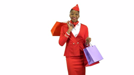 comes : Afro american girl comes with shopping bags shes a flight attendant. Alpha channel