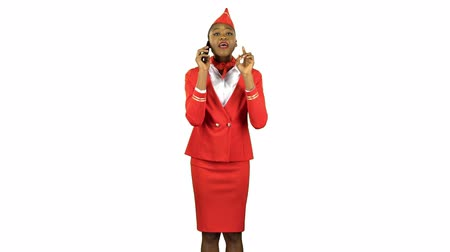 red shoes : Stewardess afro american speaks on the phone and steps away . Alpha channel