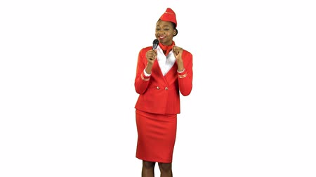 maiden : Stewardess African American in a red suit singing songs . Alpha channel