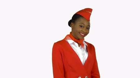 заигрывание : African American stewardess winks a slight flirt sends an air kiss. Alpha channel