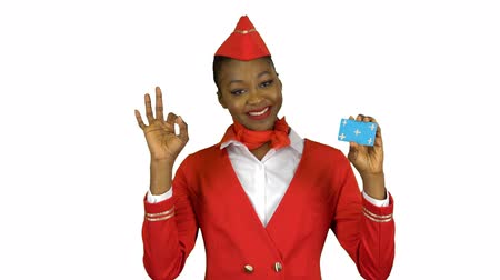 okey : Afro american stewardess girl raises a card and shows a okey . Alpha channel