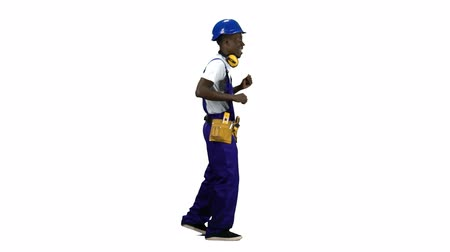 vigorous : Builder of african american appearance dances on the move . Alpha channel. Side view Stock Footage