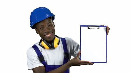 ruletka : Engineer african american raises the paper tablet . Alpha channel