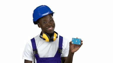 publicity : African American builder lifts blue card and shows okey. Alpha channel