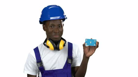 publicity : African American builder lifts blue card and shows thumbs down . Alpha channel