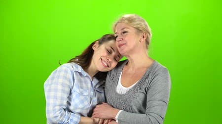 konuları : Mom and daughter on talking . Green screen Stok Video