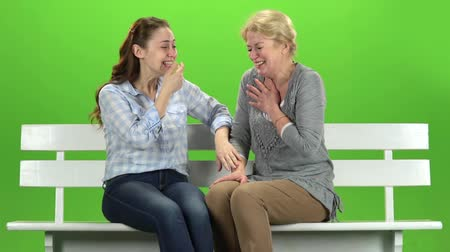 konuları : Mom and daughter laugh. Green screen. Slow motion Stok Video