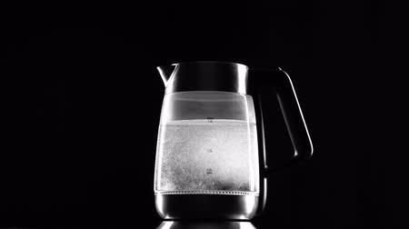 seethe : Turn on the electric kettle, it boils. Black background