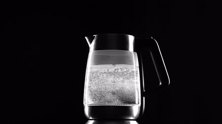 seethe : Electric kettle begins to boil. Black background