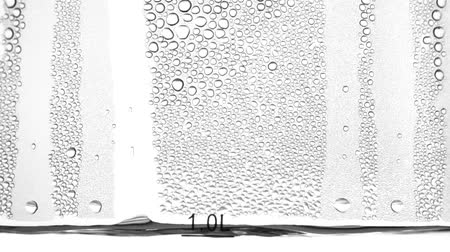 seethe : Condensate flows down the glass. Close up. Slow motion Stock Footage