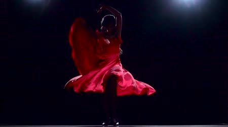 flamenco : Flamenco. Girl performs elegant movements with her hands in sexual dance. Black background. Slow motion Stock Footage