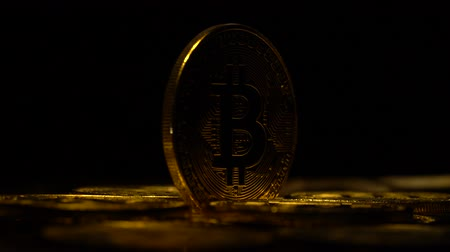 buy gold : Bitcoins are spinning in a circle in the dark on a black background. Close up
