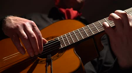 flamenco : Fingers pick the strings on the guitar. Close up Stock Footage